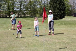 Family playing Pitch and Putt at Fakenham Fairways.